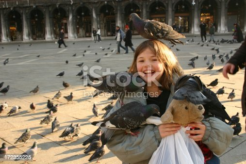 Girl in San Marco square laughing with the birds