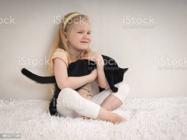 Child hugging a black kitten girl and cat sit on the bed picture id681077138?b=1&k=6&m=681077138&s=612x612&h=s6 n4uqtamqjmtzy4xurcoluejiytujl217fc9hok a=