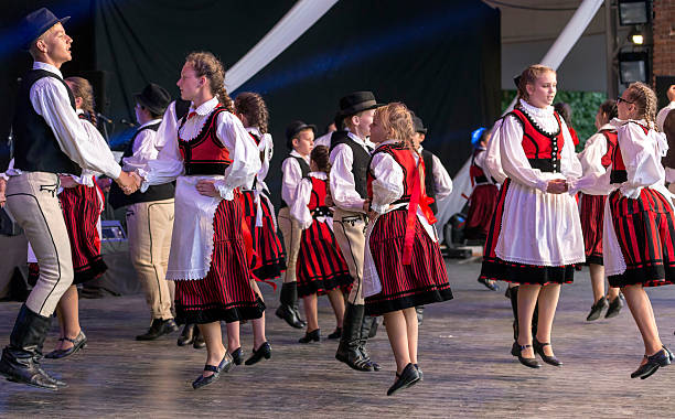 child hungarian dancers in traditional costume - ungarn stock-fotos und bilder