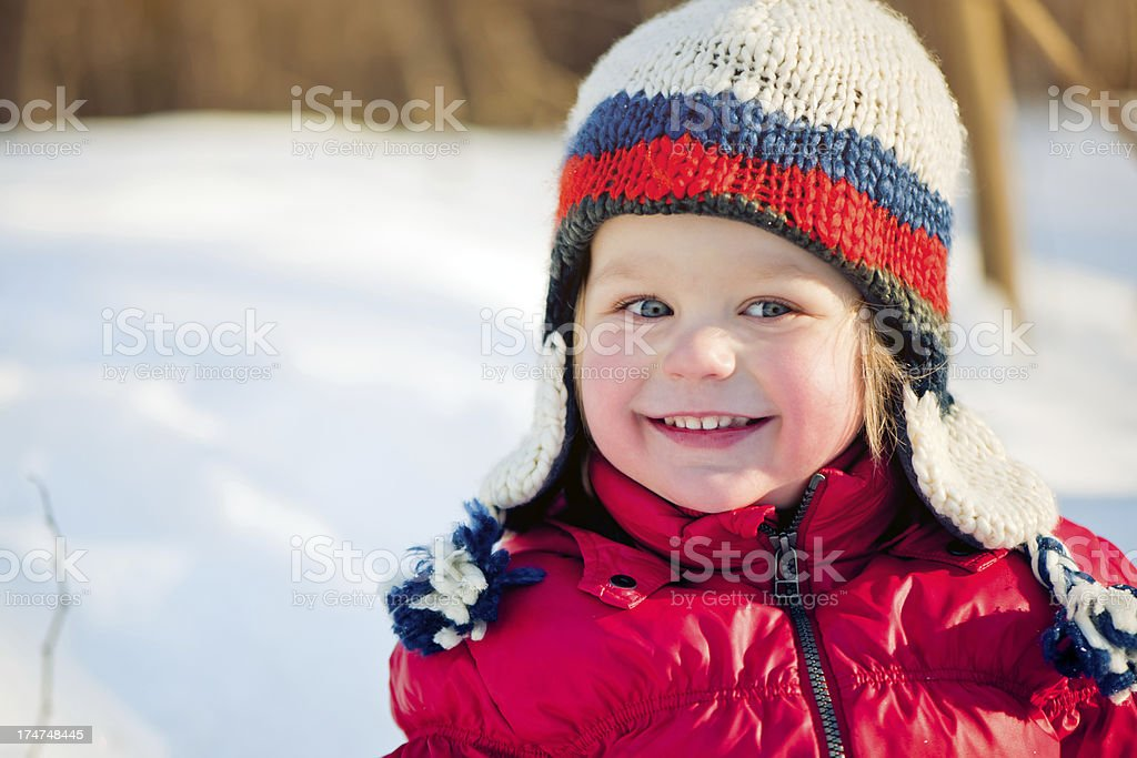 Child in a winter park royalty-free stock photo