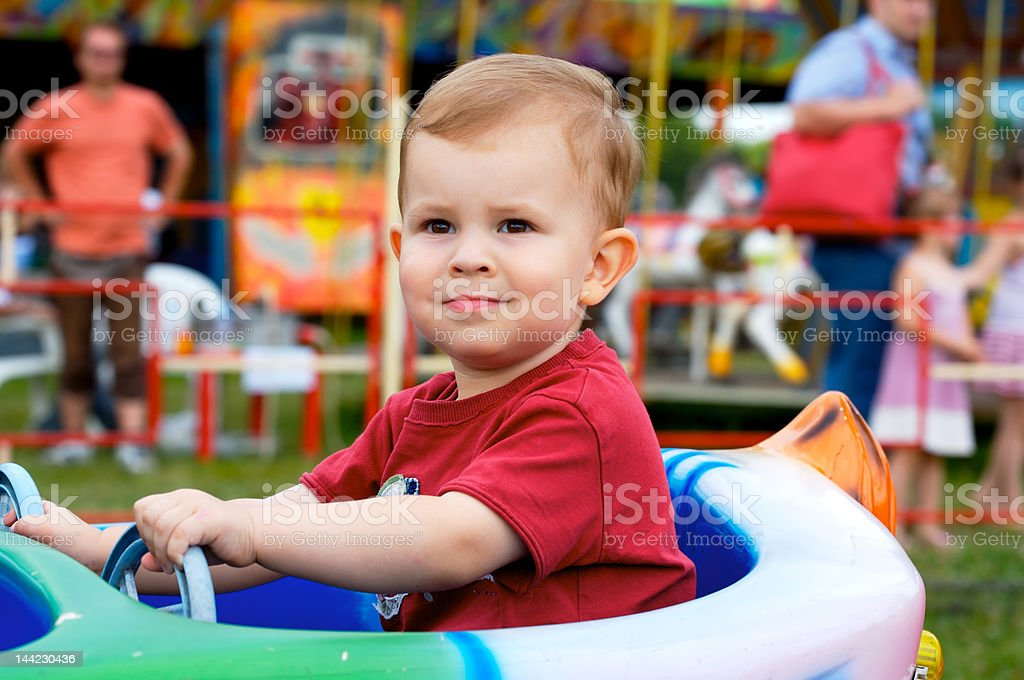 Child in amusement park ride royalty-free stock photo
