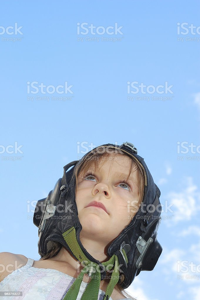 child in an old pilot helmet royalty-free stock photo