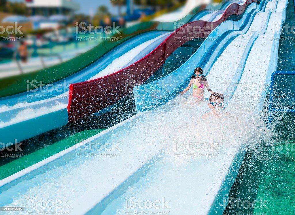 Child in aqua park stock photo