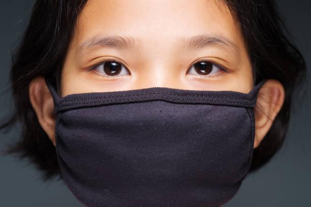 Child in Black Mask