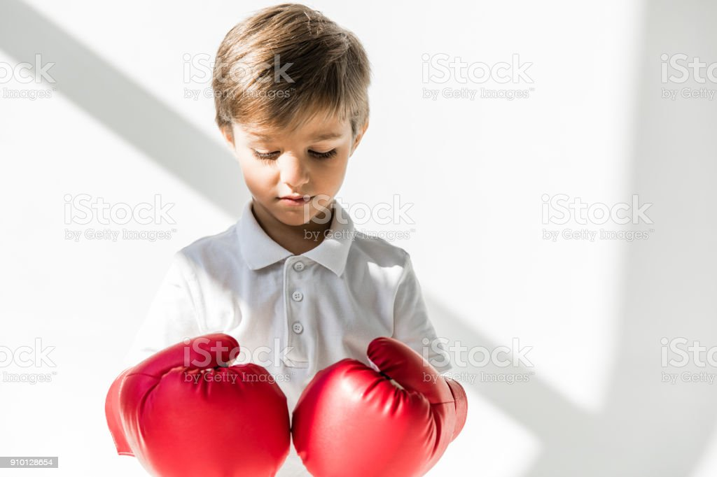 child in boxing gloves stock photo
