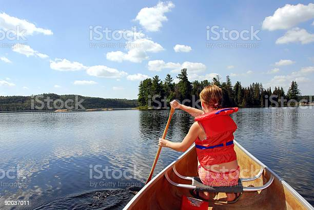 Child In Canoe Stock Photo - Download Image Now