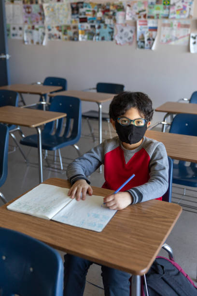 Child in Classroom Coronavirus stock photo