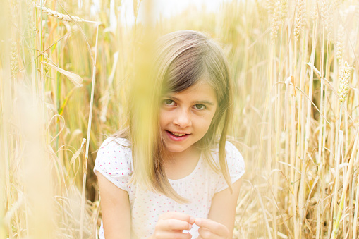 Child in field with crops