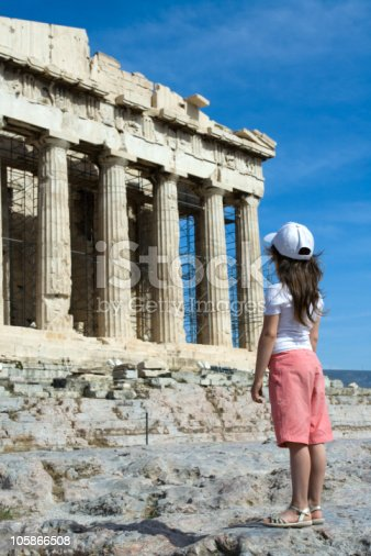 istock Child in front of Ancient Parthenon Acropolis Athens Greece 105866508