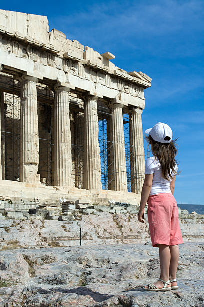 Child in front of Ancient Parthenon Acropolis Athens Greece stock photo