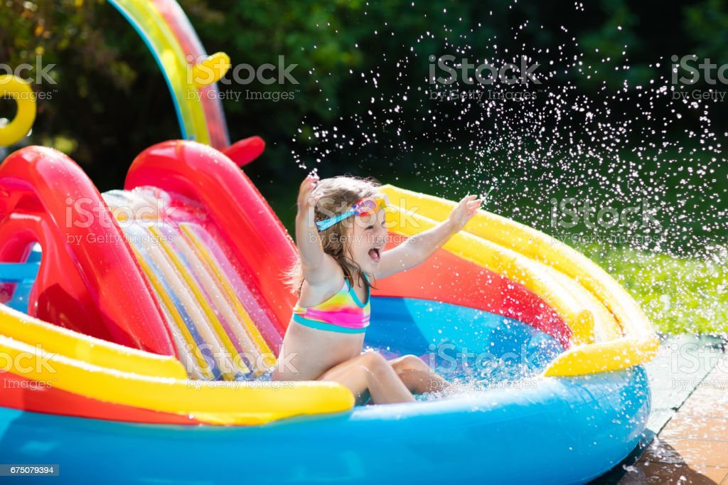 Child In Garden Swimming Pool With Slide Stock Photo Download Image Now Istock