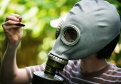 Child in Gas Mask Examining Roach