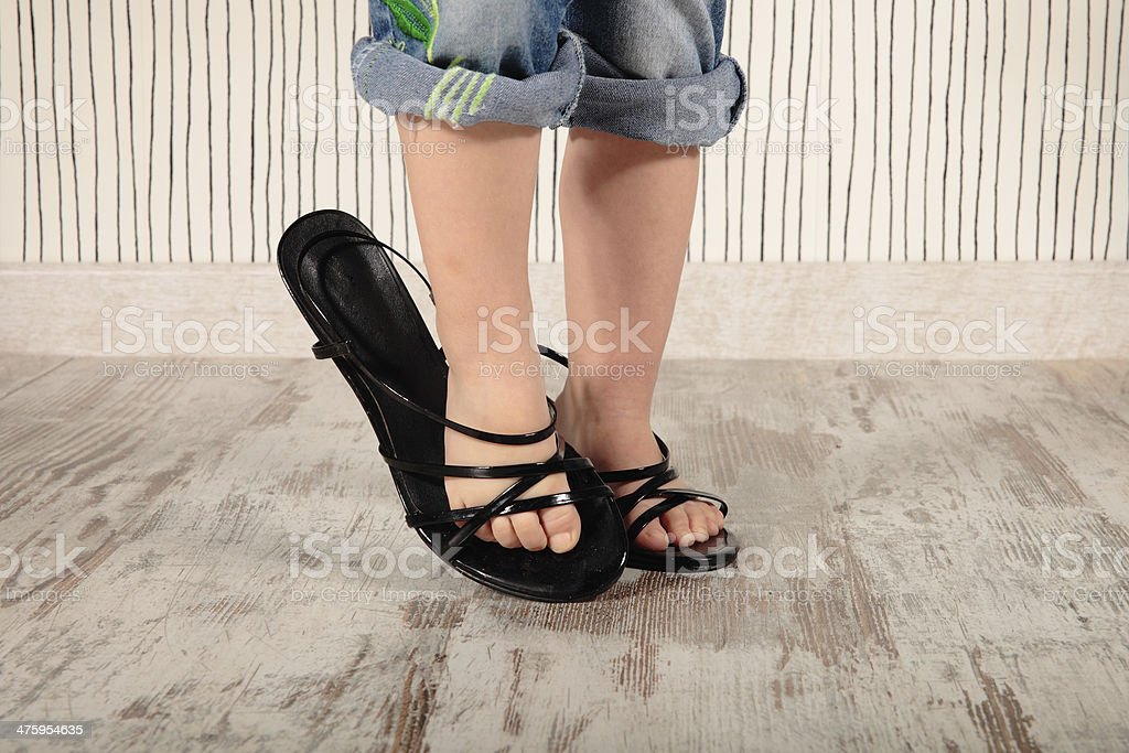 child in heels stock photo