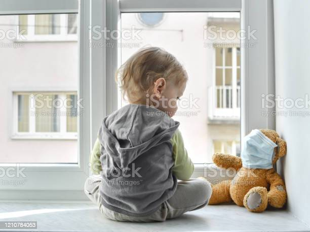 Child in home quarantine standing at the window with his sick teddy picture id1210784053?b=1&k=6&m=1210784053&s=612x612&h=syk9dyyl vbg llordfzgfqwzbtrymlquf2edtxjojo=
