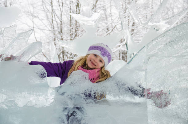child in icy kingdom in winter time