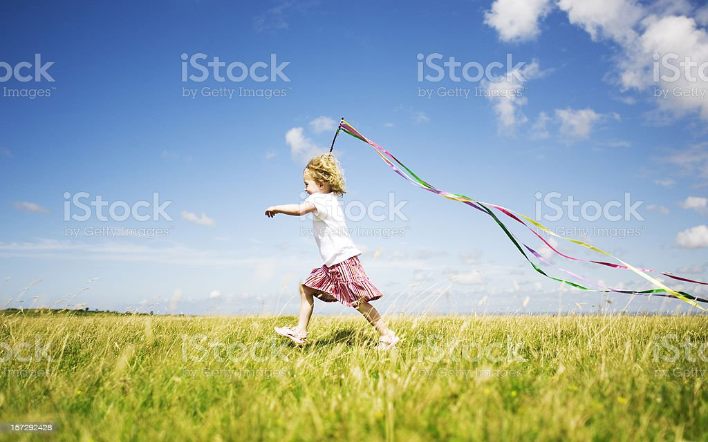 Child in meadow stock photo