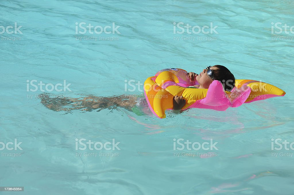 Child in Pool on Inflatable royalty-free stock photo