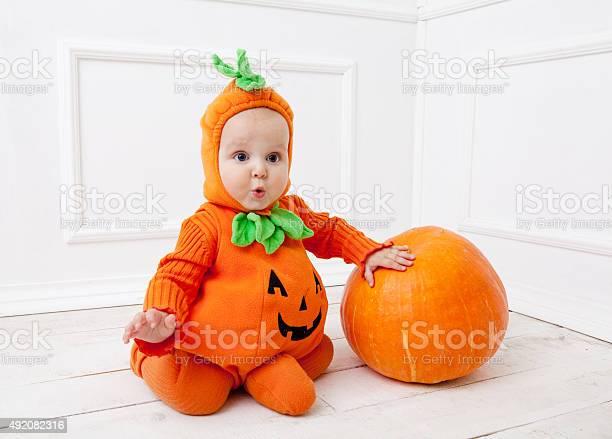 Child in pumpkin suit on white background with pumpkin picture id492082316?b=1&k=6&m=492082316&s=612x612&h=upgk3n2yjh9cfmoittbxwwpdkgu7aqukwpn2sczwsf4=