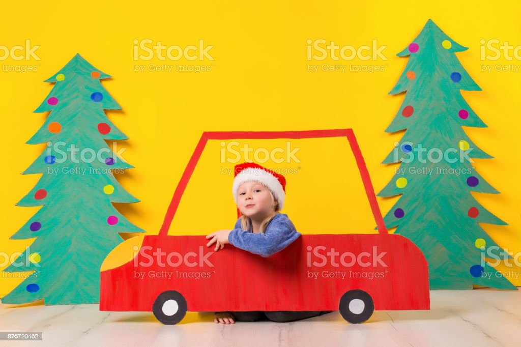 Child in red Christmas car. Xmas holiday concept stock photo