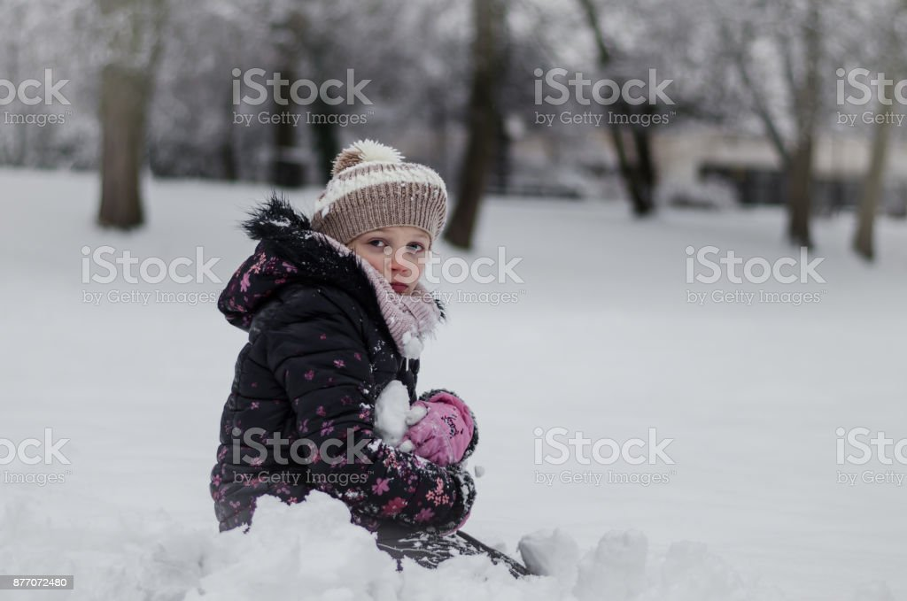 child in snow stock photo