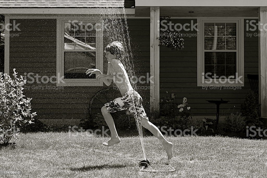Child in Sprinkler royalty-free stock photo