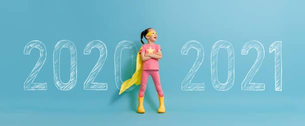 Child in superhero costume between 2020 and 2021 stock photo