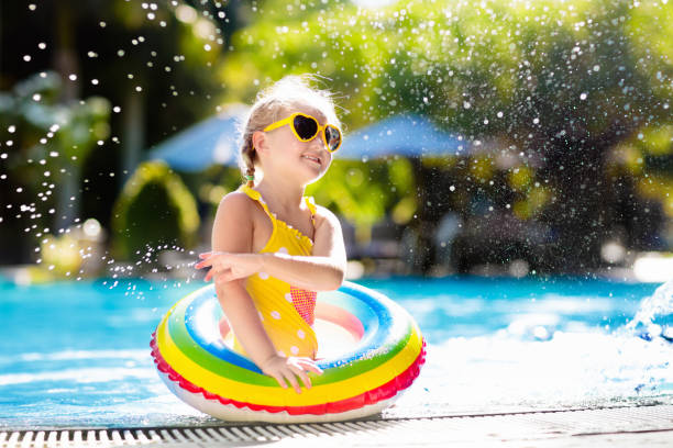 child in swimming pool. kids swim. water play. - jumping into water stock pictures, royalty-free photos & images