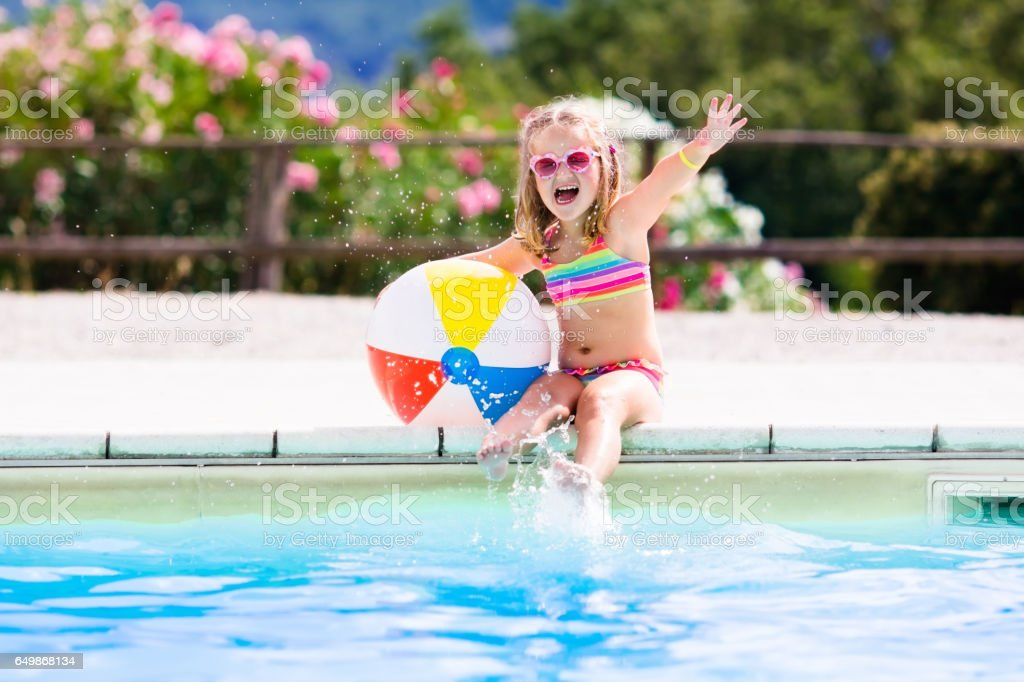 Child in swimming pool on summer vacation - Photo