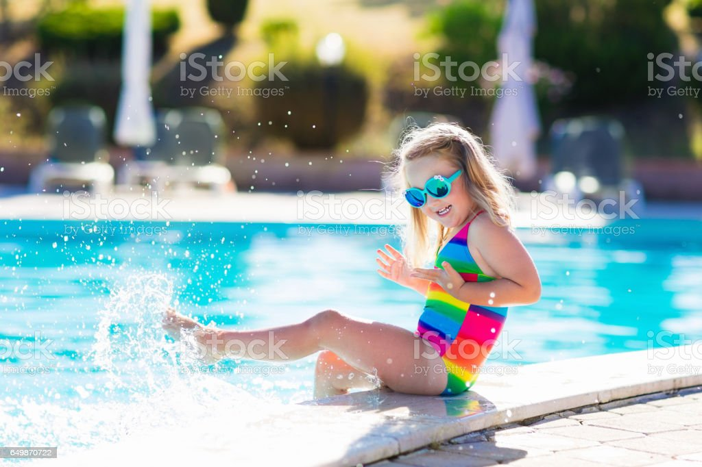 Child in swimming pool on summer vacation stock photo