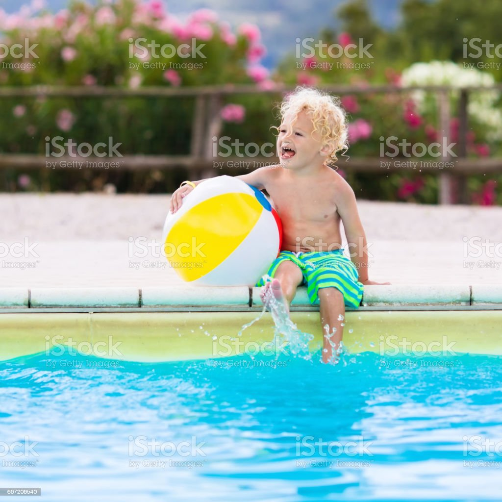 Child in swimming pool on summer vacation royalty-free stock photo