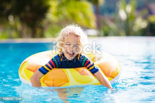 1080429798istockphoto Child in swimming pool. Summer vacation with kids. 1080427348