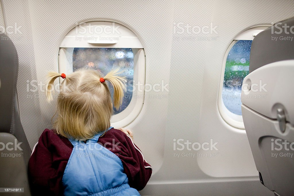 child in the airplane royalty-free stock photo