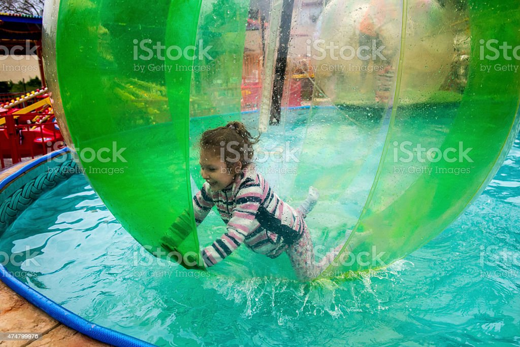 Child in the ball on water stock photo
