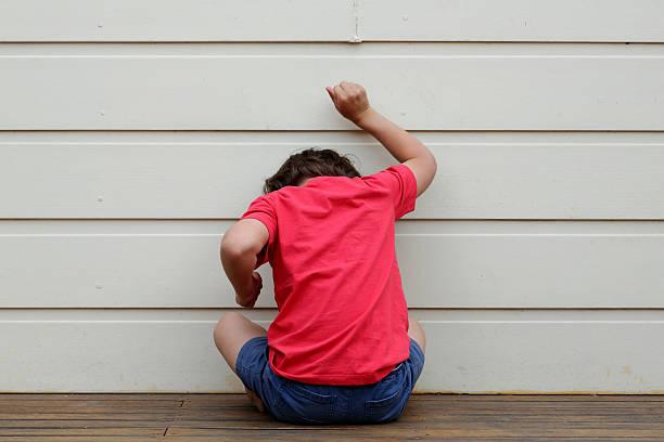 child in trouble. - otizm stok fotoğraflar ve resimler