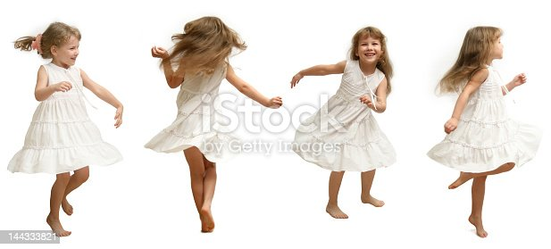 istock Child in white dress showing the movements of dance 144333821