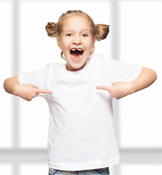Child in white t-shirt stock photo