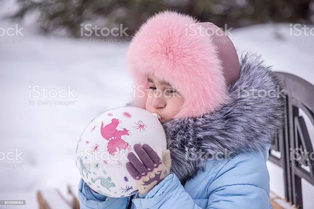 child inflates ball stock photo