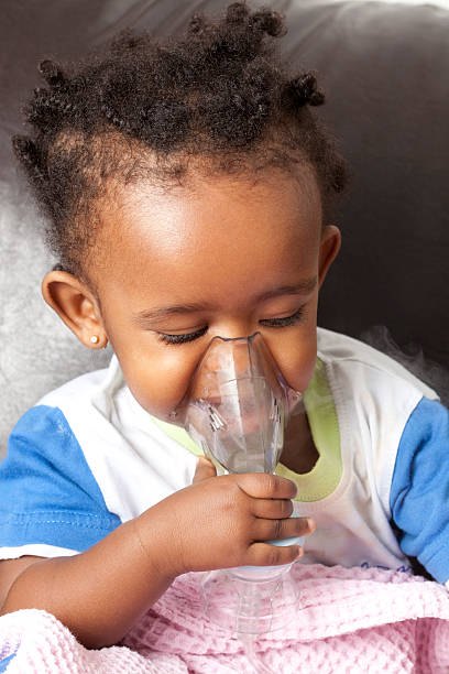 Child inhalation. Sick little child girl with inhalation mask. smoke inhalation stock pictures, royalty-free photos & images