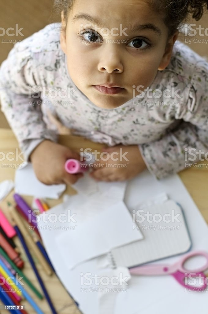 Child is drawing at nursery stock photo