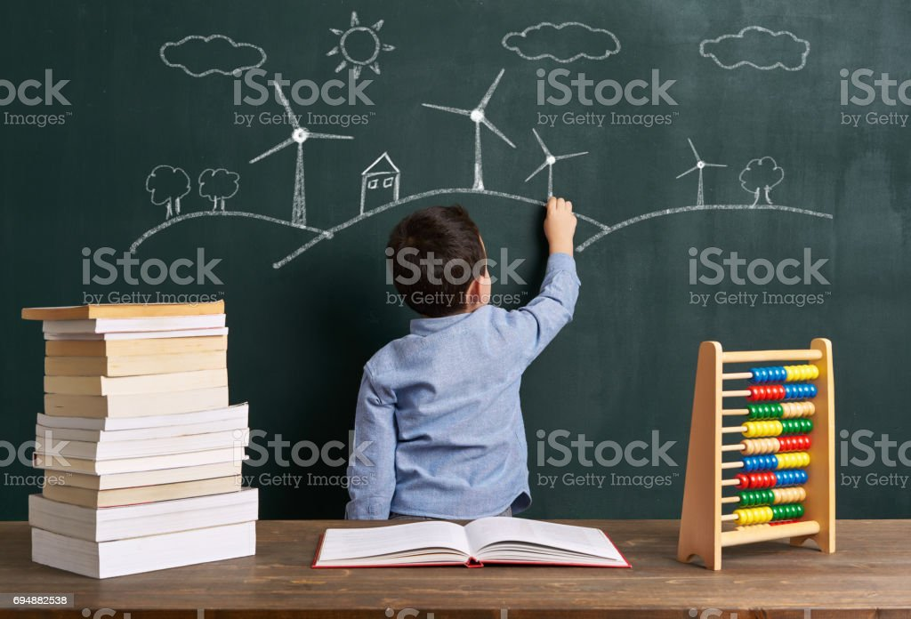 Child is drawing wind turbine stock photo