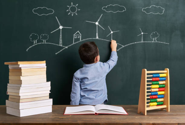 Child is drawing wind turbine stock photo