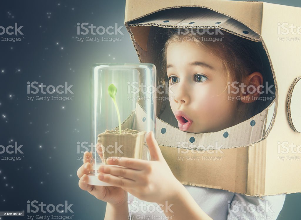 Child is dressed in an astronaut costume stock photo