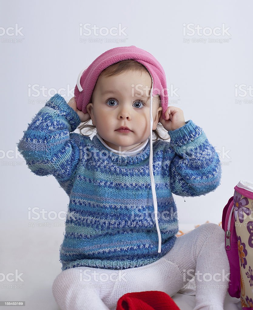 Child is dressing a hat royalty-free stock photo