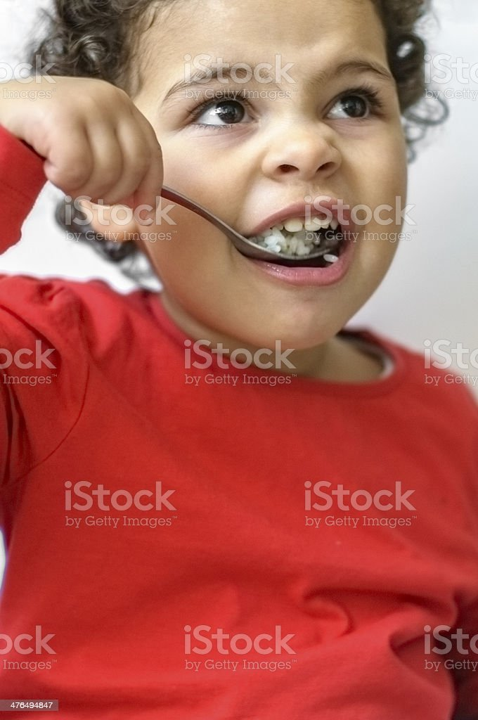 PEOPLE: Child Is Having Rice for Lunch royalty-free stock photo