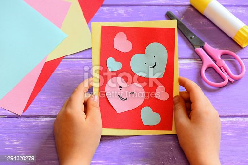 Handmade Happy Valentines day greeting card background. Valentines day card hearts smiles. Valentine's day gift surprise. DIY handmade Valentine postcard. Heart shape paper cut. Paper cut out hearts. Paper cutting love. Kids Valentine's day crafts diy. DIY valentines for kids. Valentines crafts. Child Valentine card. Valentines paper craft ideas kids. DIY Mothers day. Mother's day craft. DIY Birthday card