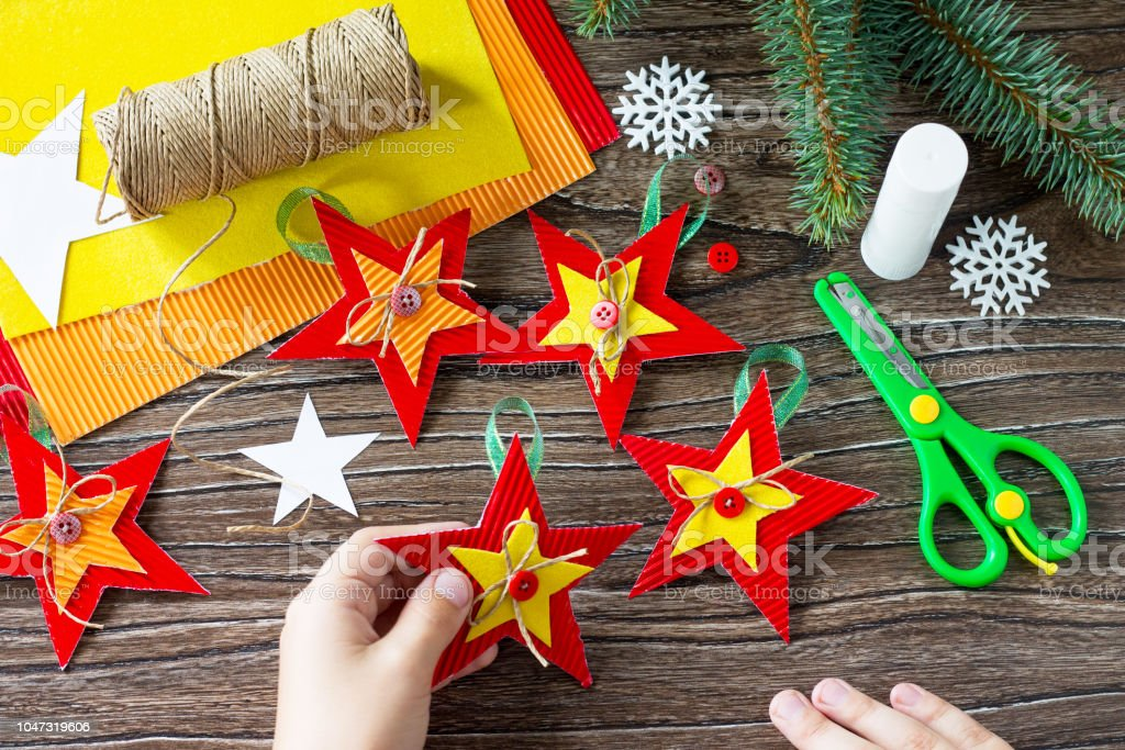 A Child Is Holding Christmas Tree Toys Star Gift Handmade Project Of