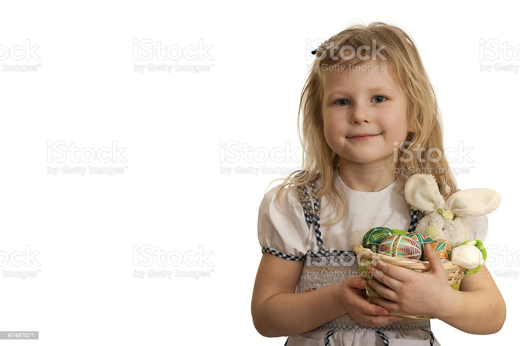 Child is holding Easter rabbit and painted eggs royalty-free stock photo