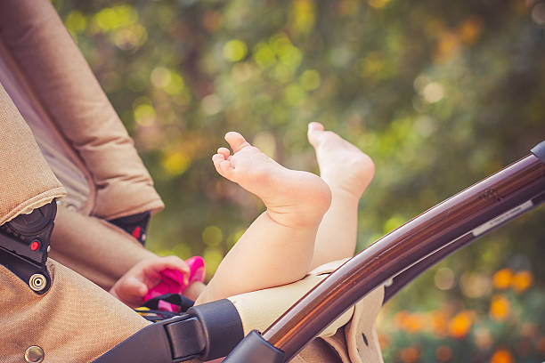 child is lie in a carriage. stock photo