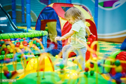 istock child is playing in the children's room. Children in the entertainment center. Fun in the children's playroom. 925721828