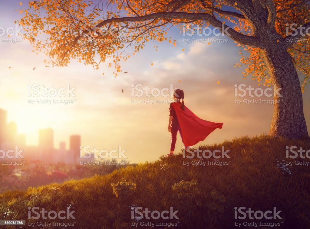 child is playing superhero stock photo